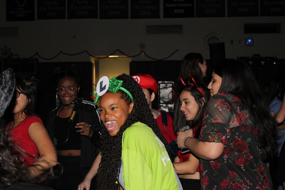 A group of Sophomores laugh as they dance to the music.