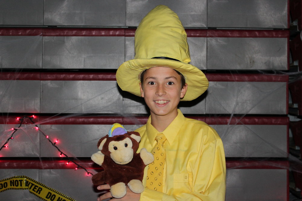 A student shows off his Curious George inspired outfit.