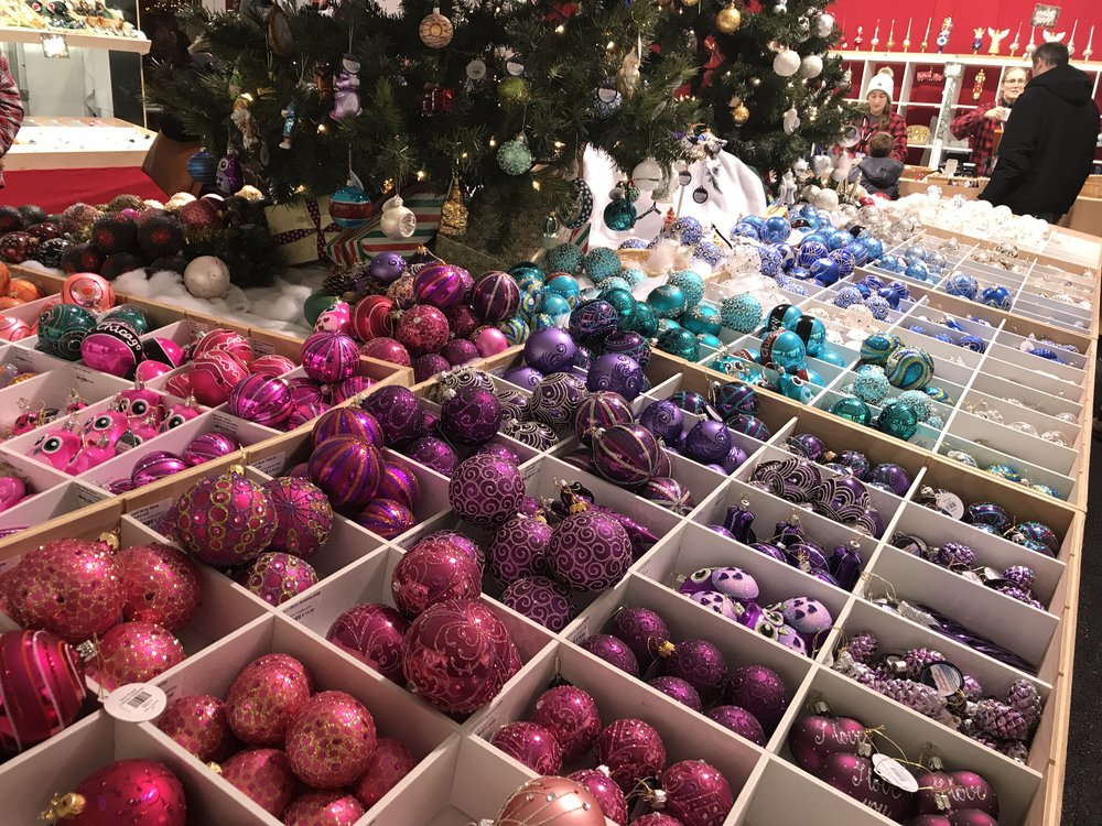 Shops display different colored ornaments for sale.
