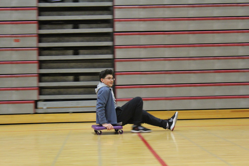 Adam Djoudi, Adv. 209 looks on as he maintains his lead during the scooter race