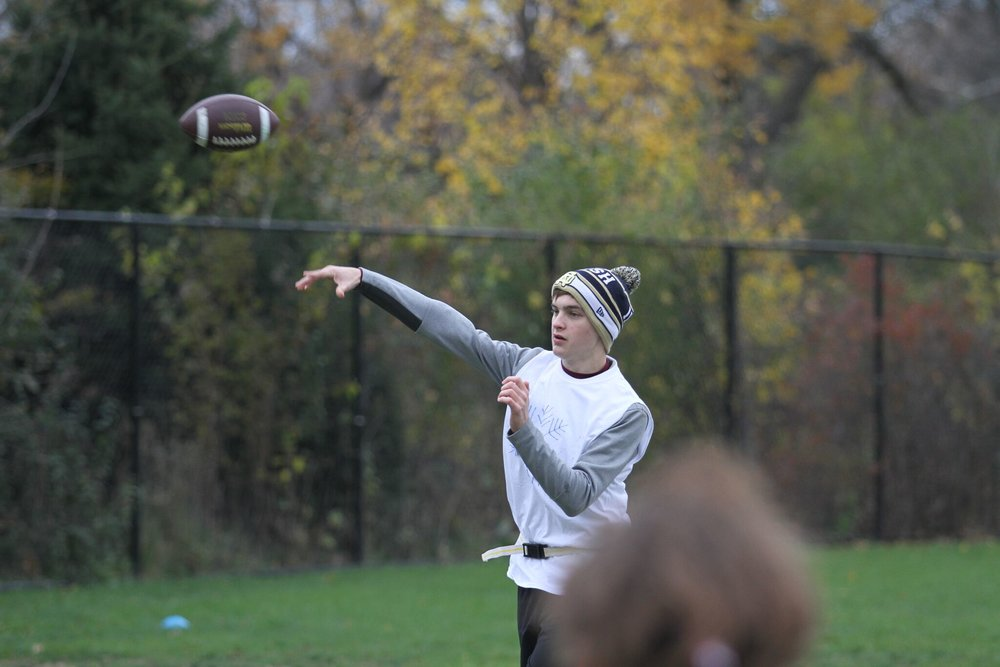 Liam O'Connor, Adv. 004, throws a pass to his teammate.