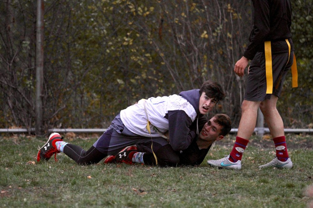 Danny O'Connor, Adv. 901, and Campbell O'Conor, Adv. 903, wrestle for the ball.