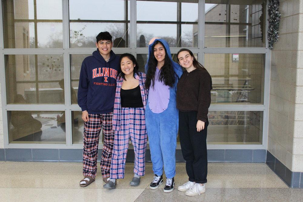 Adrian Garces, Adv. 900, YooJin Yoon, Adv. 903, Esther Huescas, Adv. 911, and Kimberly Grabiec, Adv. 902, representing the Hoofbeat for Pajama Day