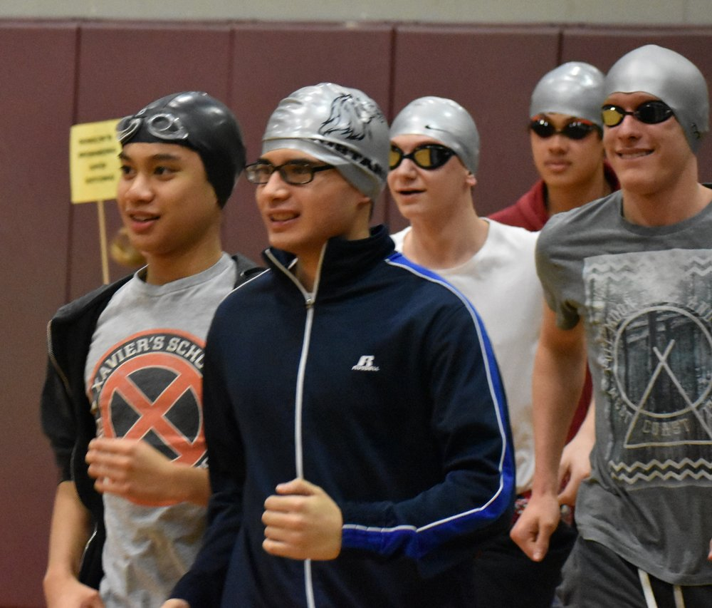 Robert Claud, Adv. 911, and the rest of Men's Swimming and Diving team during the Pep Rally showing off for Color Wednesday