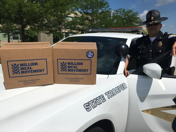 Photos show ISP Cpl. Daniel Avitia picking up meals for the Lowell District. Courtesy of Indiana State Police.