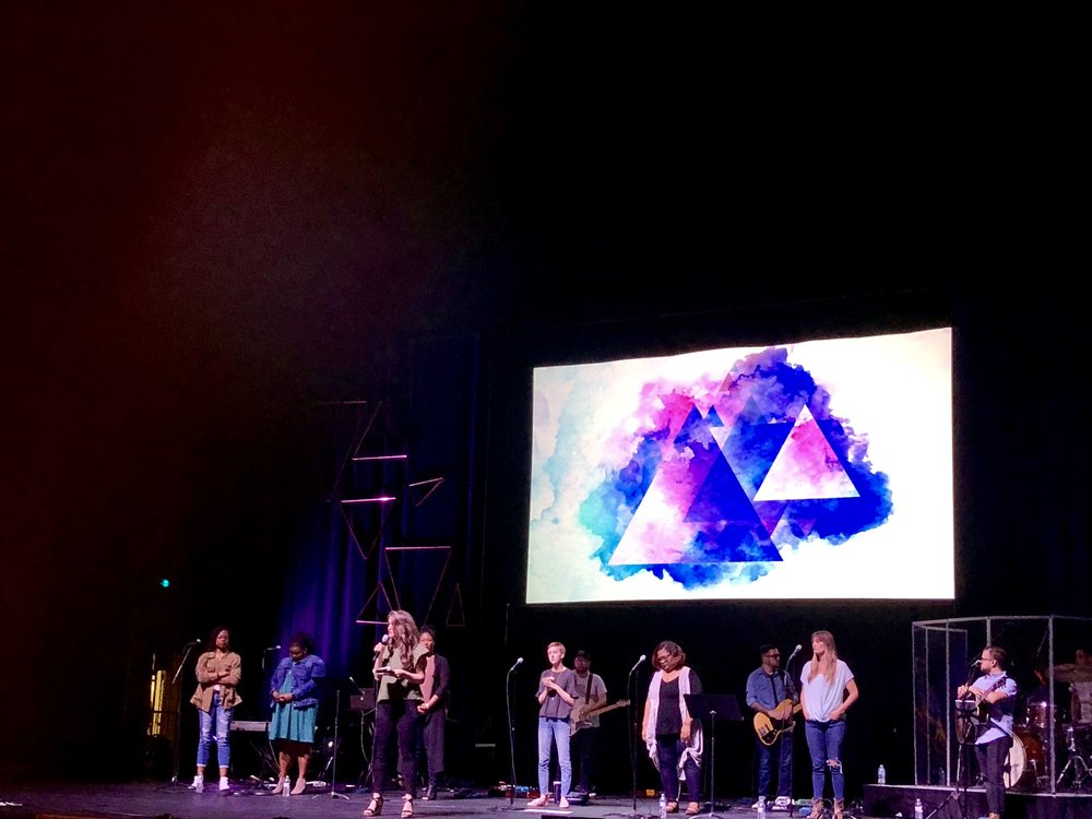 This worship team was so incredible. And here is a photo of our friend Jenn Jett reading from 1 John at the beginning of day 2.