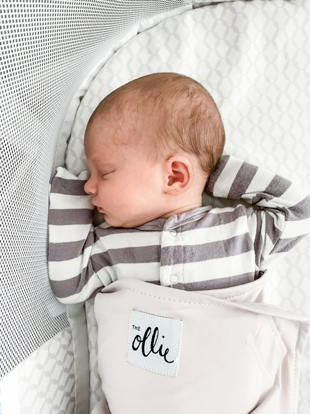 She got her arms out this time (totally user error on our part) but most of the time she's a snug little burrito and we love it!