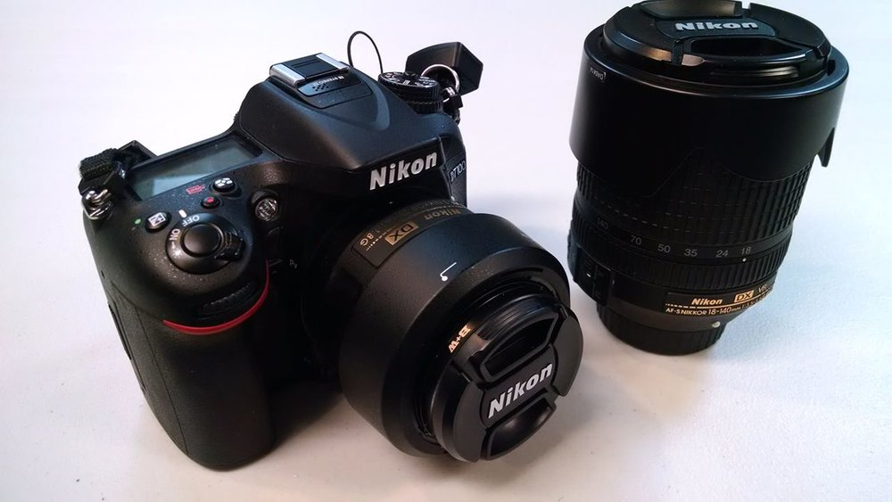 My current kit, a Nikon D7100 w/ 35mm f1.8 and 18-140mm zoom
