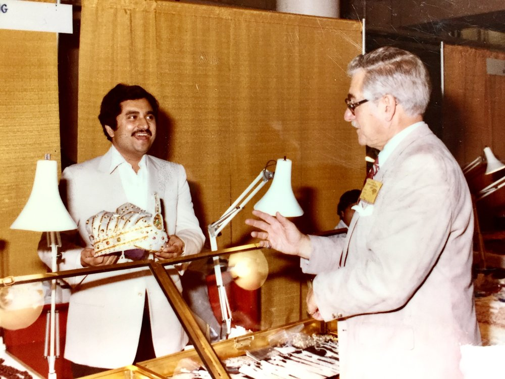 Herbert Duke, Sr. shows his crown collection at an InterGem Jewelry Show in 1981.