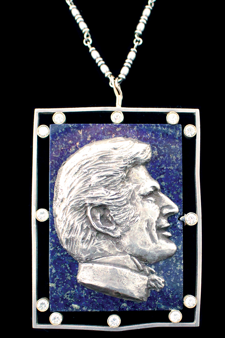 Diamond and lapis pendant with silver chain from the estate of Liberace,