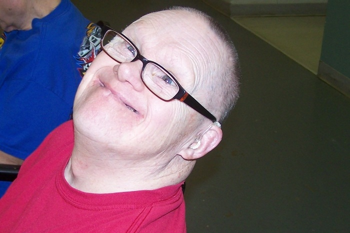 Mary's brother, Dick, smiling at the camera