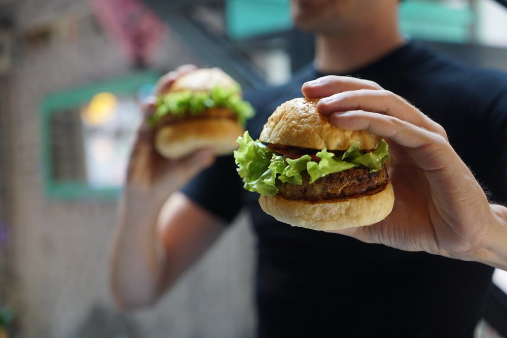 People who eat the equivalent of about two burgers a week see a reduction of more than five pounds in their CO2 emissions per day.