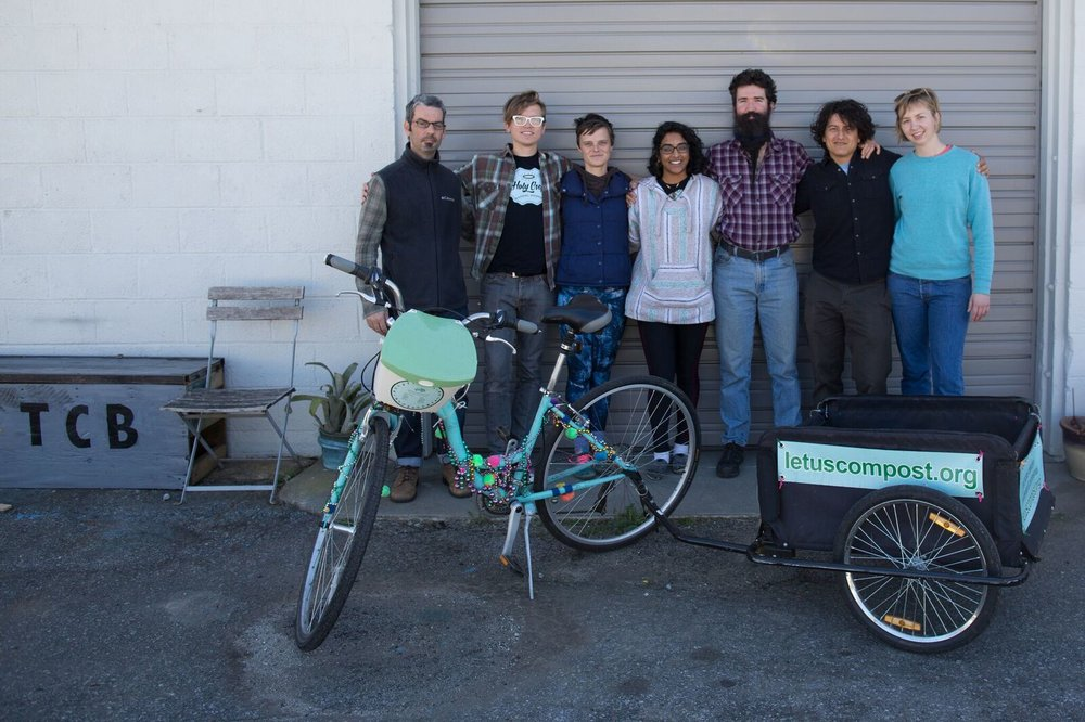 Kristen Baskin (third to left) and her team of haulers at Let Us Compost. Some of them manage their pickups by bike, the ultimate in a carbon-friendly transaction. Photo from  Let Us Compost