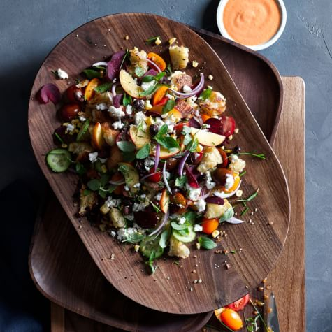 This gorgeous panzanella salad is fresh, vibrant and utilizes two of summer's best produce items - peaches and tomatoes. Bring it with you to dinner parties, picnics, and beyond. Photo from   Williams Sonoma