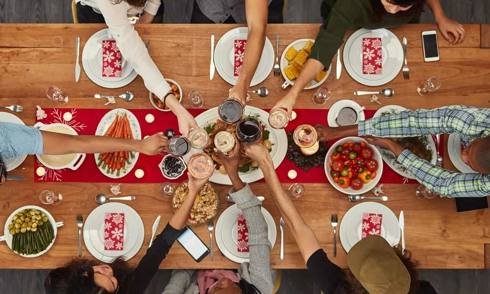 According to a new study, there are tons of benefits to eating with friends and family. Photo credit: Getty Images.