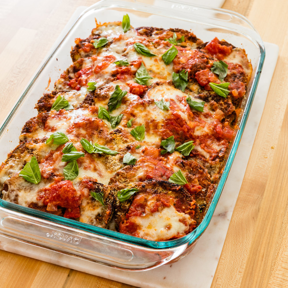 Photo source . Everyone loves a good warm, flavorful eggplant parmesan. This take on the classic dish is simple, fresh, and oh-so-satisfying.