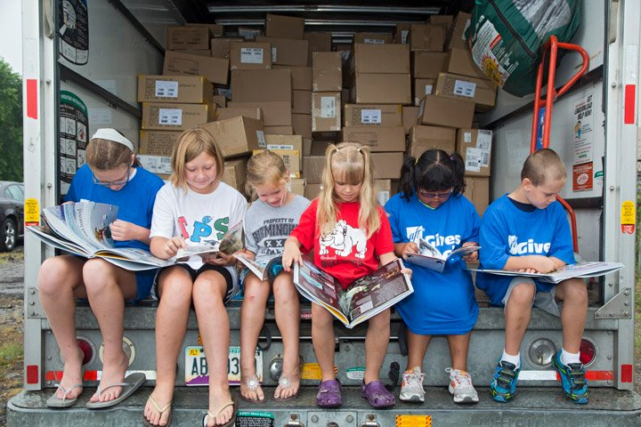 Supplying books to kids in underserved communities significantly increase their interest in reading. Photo source: First Book