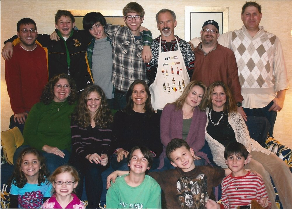 The author's family at a reunion in 2011. Six out of 19 are vegetarians. Top row brother-in-law Eric (vegetarian), nephew Jonah, Noah (vegetarian), nephew Gabriel (vegetarian), husband David, brother-in-law David, brother Josh. Middle: sister Missy, niece Hannah, the author (vegetarian), sister-in-law Becca, sister Wendy (vegetarian). Floor: niece Abby (vegetarian), niece Maddie, Aidan, nephew Zachary, nephew Ben.