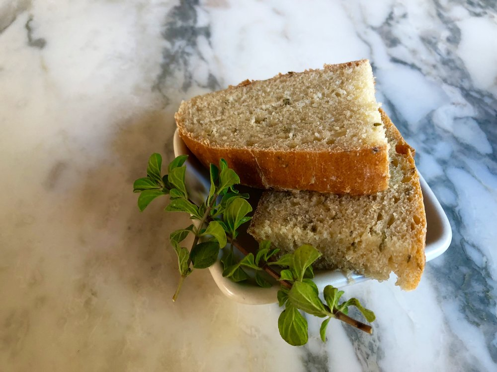 Pulling a hot loaf of bread from the oven can only get better with the addition of fresh herbs. For more at home bread-baking tips, including how to get a crunchy top, peruse the King Arthur  website . Dip a slice of bread in olive oil or top it with roasted garlic spread.
