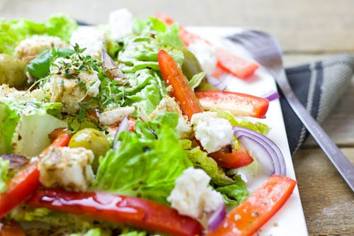 Adding a salad loaded with veggies is an easy and healthy way to fill out a meal.
