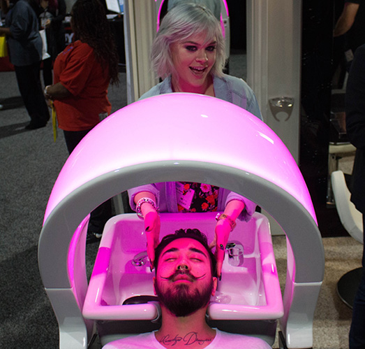 JCUS Stylists at the ISSE Show in Long Beach checking out some state of the art equipment. - ISSE SHOW LONG BEACH