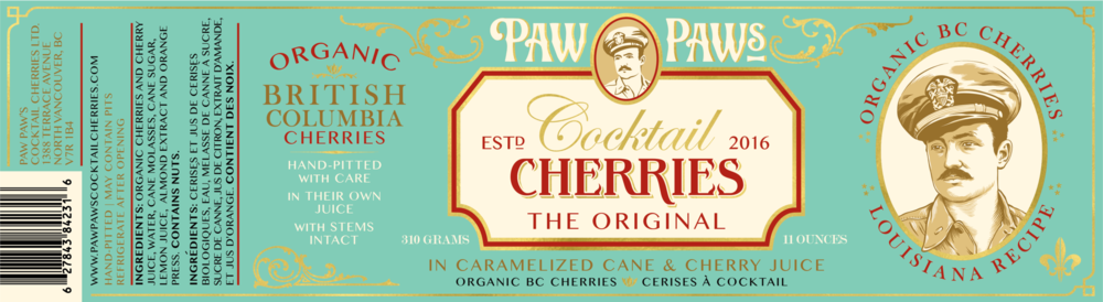 Paw Paw's Cocktail Cherries feature reflective gold turquoise labels in glass jars with gold lids. Perfect gifts.