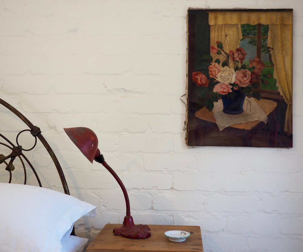 Details like the old oil painting and the industrial lamp add character, texture and beauty.
