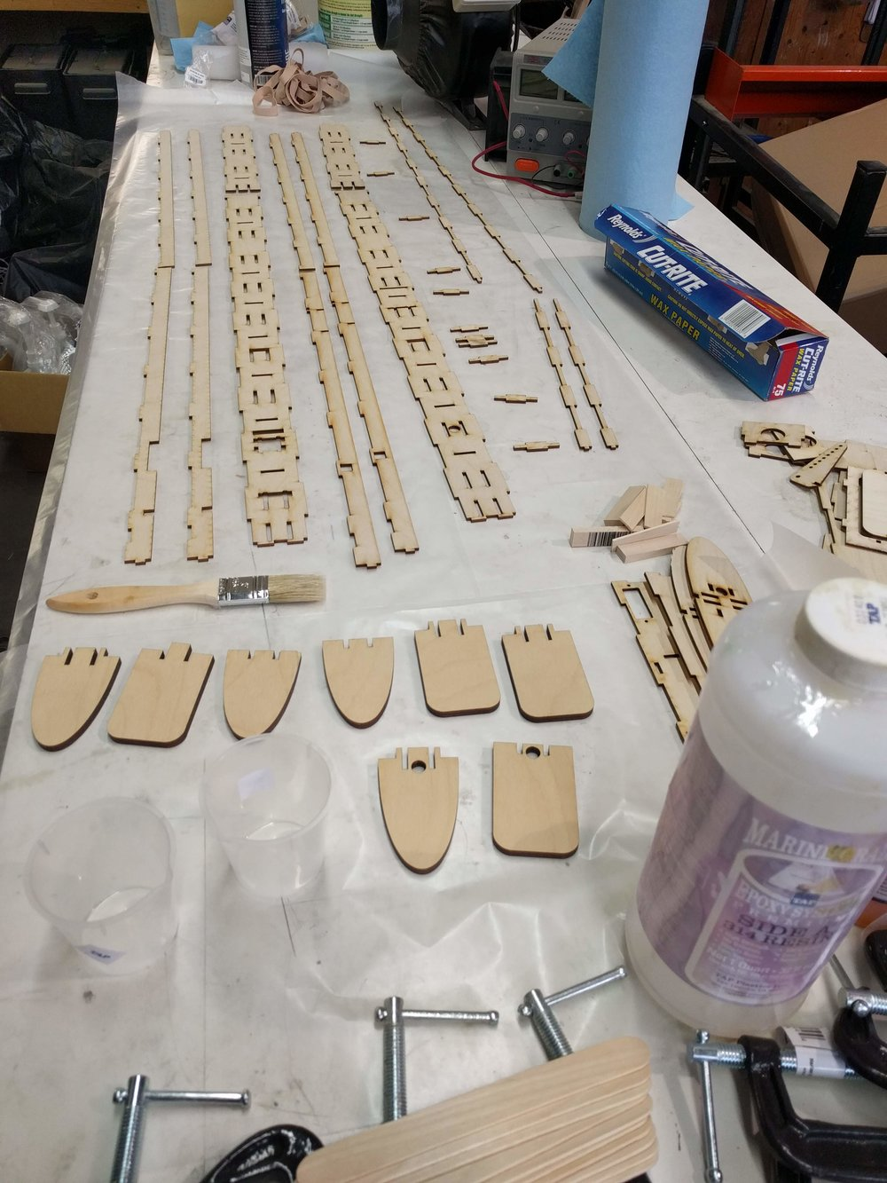 Lasercut parts for the frame laid out prior to assembly.