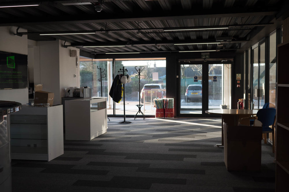 Standing at Reception looking onto Cafe area