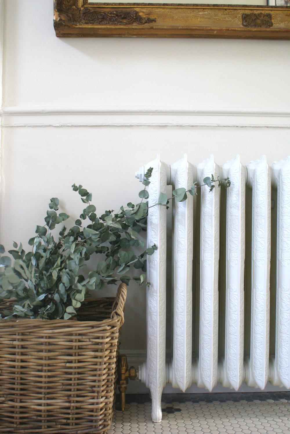 Cast iron radiator hallway with basket.jpg
