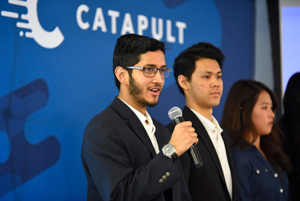 Mohammed Nasir, Founder of Drones for Humanity, pitching at QØ's Catapult Incubator Demo Day with his teammates