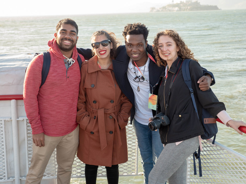 Deepak, Francesca, Mackendy, and Anna, our Community Team Members,on a ferry ride in San Francisco
