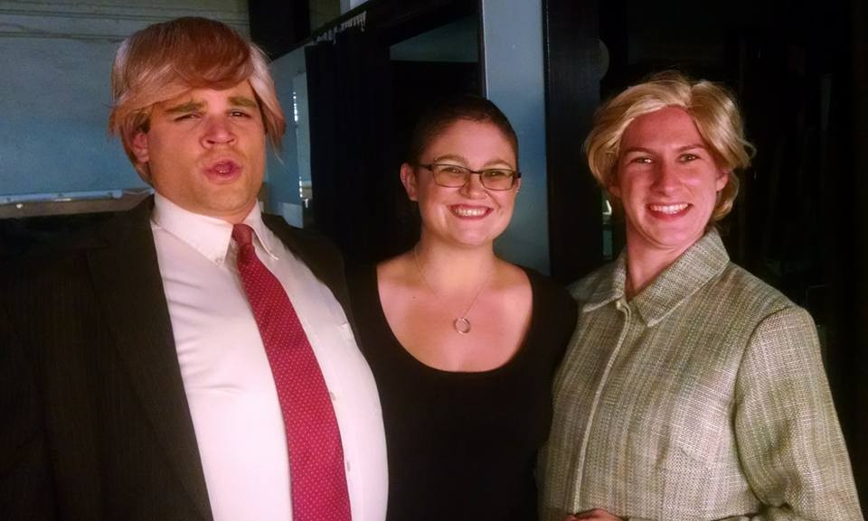 Zach Bopst as Donald Trump, Alice Stanley as Musician, and Caitlin Carbone as Hillary Clinton.