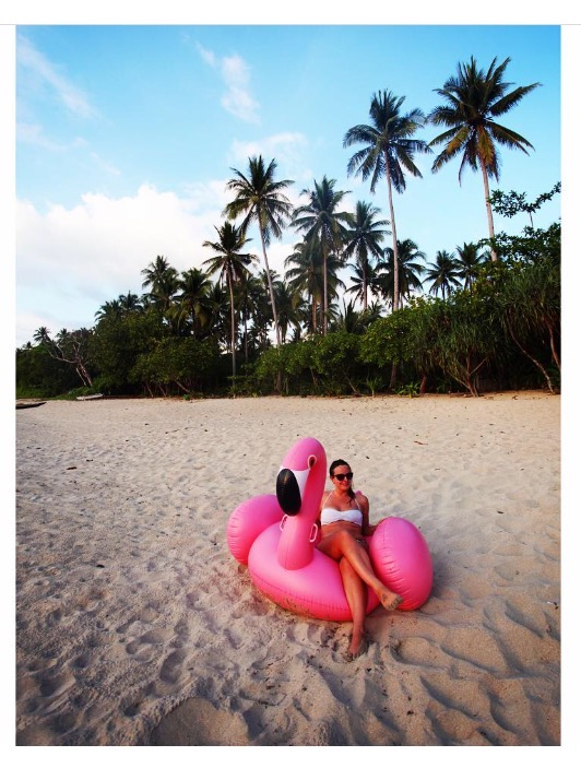Contemporary Class editor, Katie Silcox, with a Sunnylife flamingo on the beach in Rizal, the Philippines