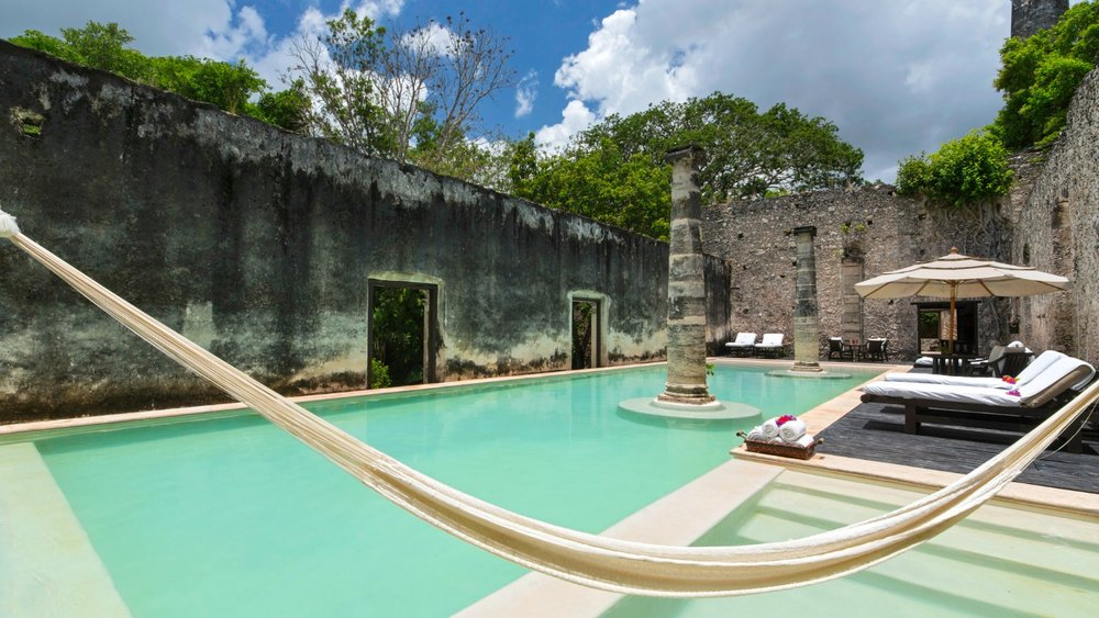 Hacienda Uayamon's pool set amongst historic ruins