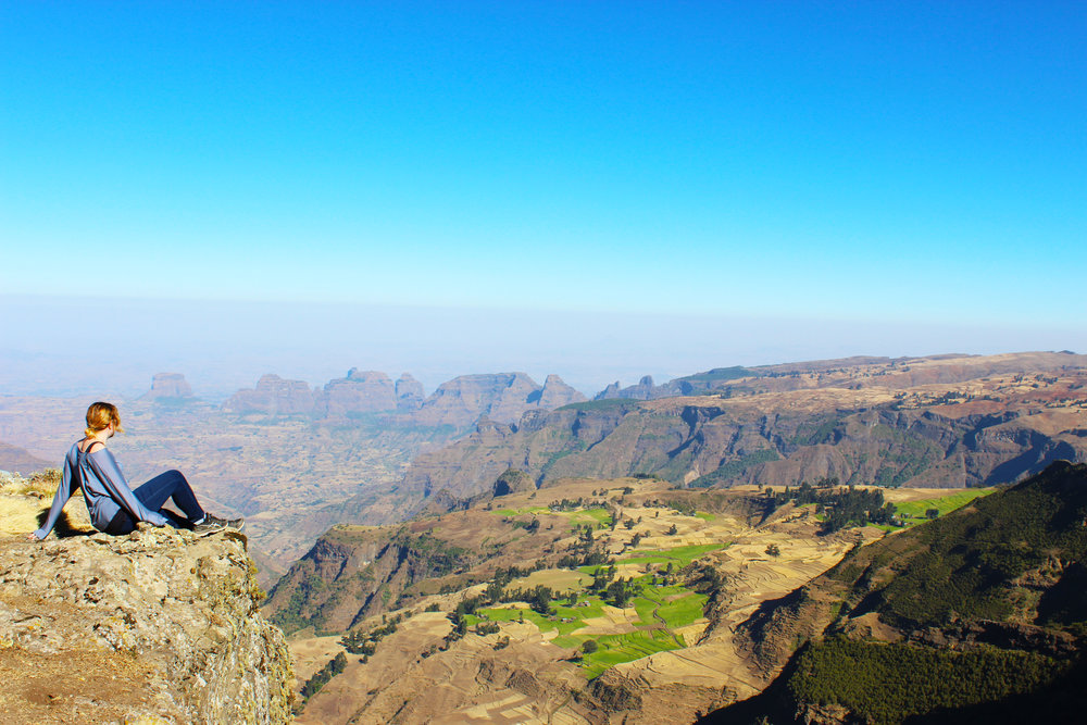 Katie Silcox taking in the views of Ethiopia's Simien Mountains. Photo Credit: Katie Silcox