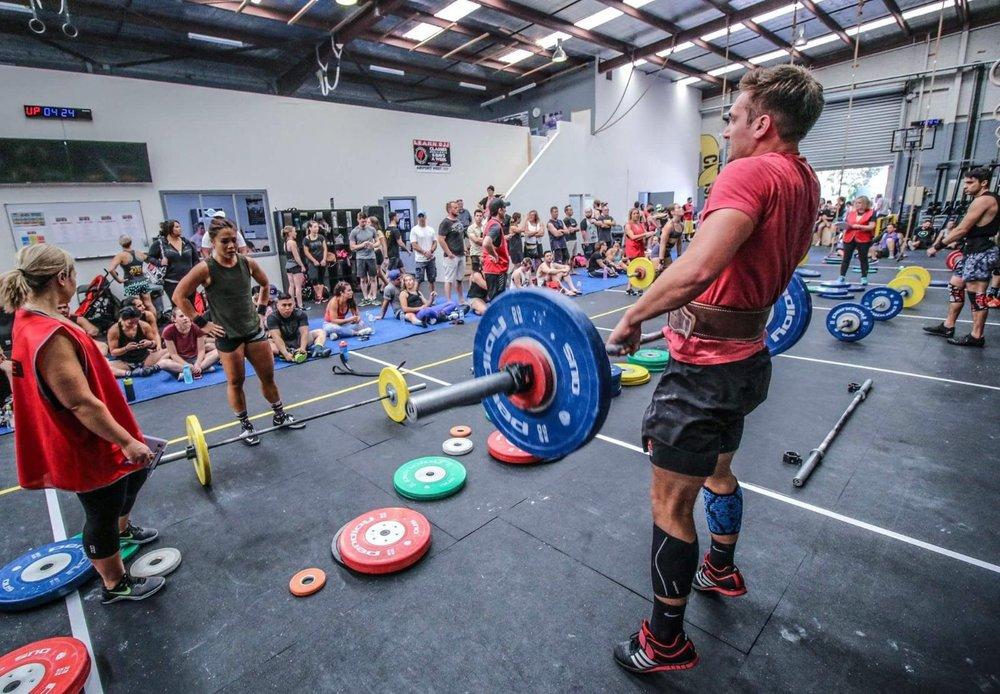 Matt mid lift at Mixed Mayhem, a local competition at CrossFit Vault