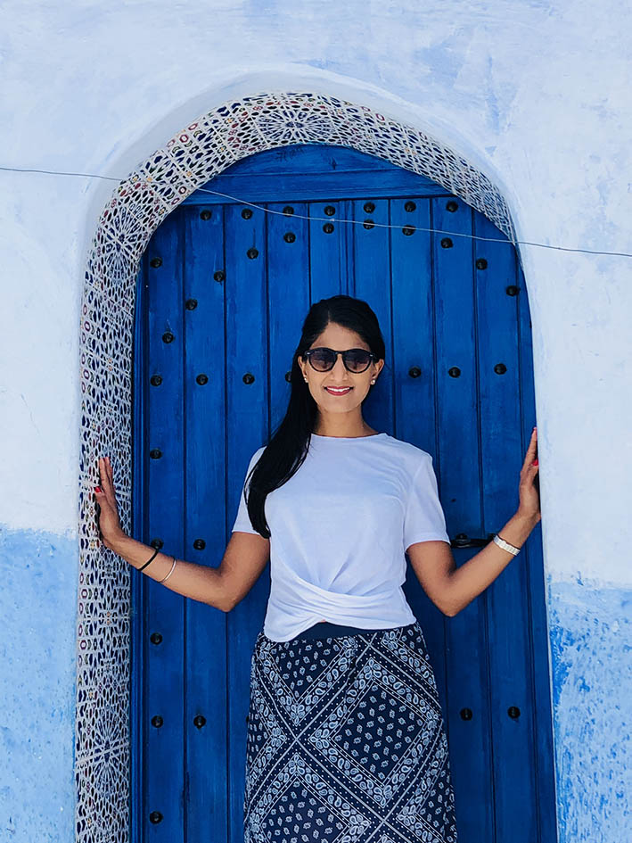 Contemporary Class photographer, Pooja Bowry, finds some shade in a Chefchaouen doorway.  Get social and share the incredible city of Chefchaouen below.