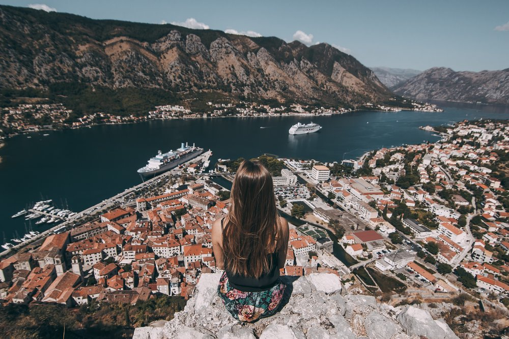 Girl looks out onto Bay of Kotor, Montenegro