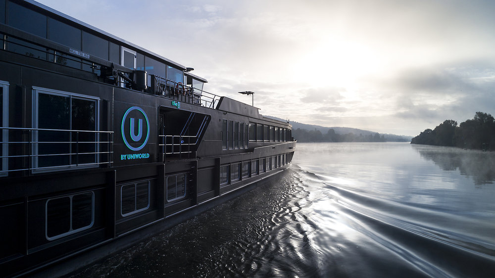 The aft deck of a U by Uniworld boat cruising the canals of Europe. Image credit - U by Uniworld