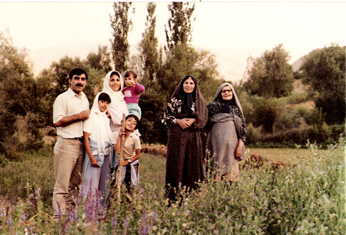 Pontia with her parents, siblings and grandmothers in Taleghan, Iran in 1981. Pontia is being held by her mother.