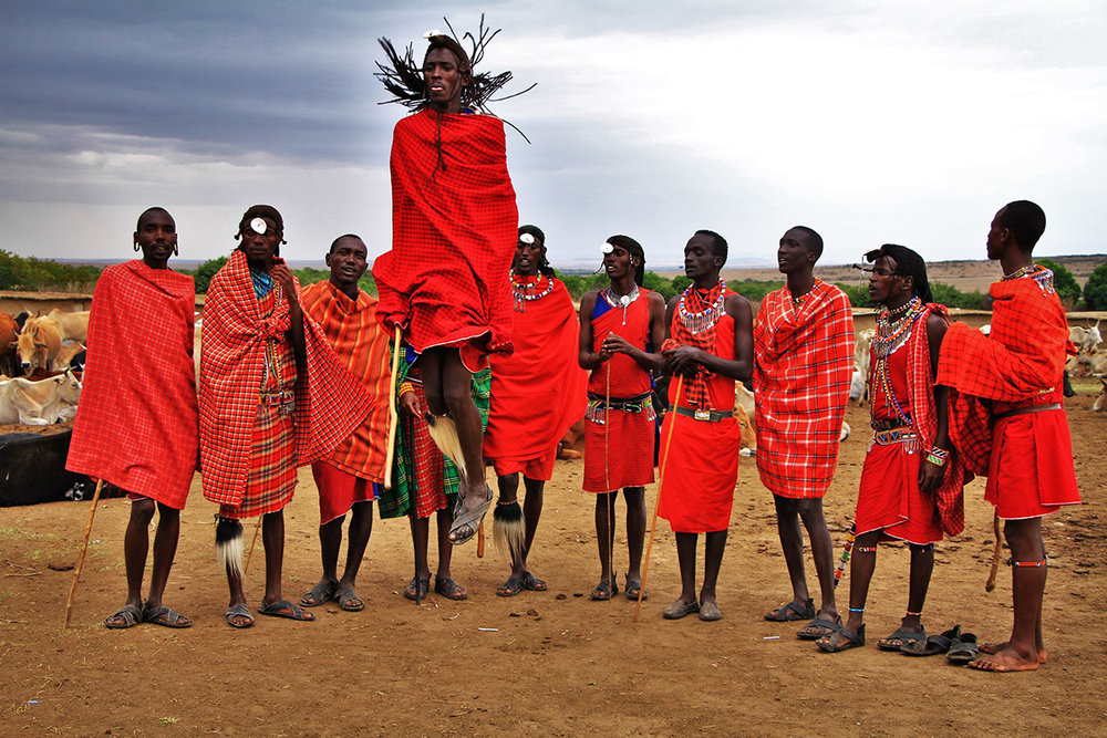Male members of the Maasai Tribe in Kenya, wearing red shúkàs and beaded jewellery.