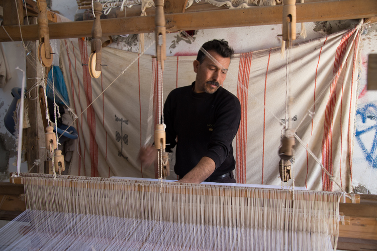 Salah practices his craft, using a traditional loom in Tunisia
