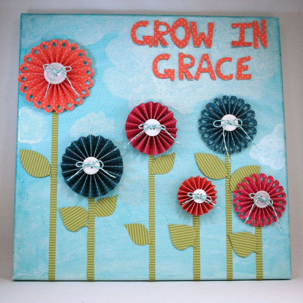This canvas wall hanging also uses the  Rosettes Die  set.  I love how this set has a scalloped edge rosette and a straight edge rosette.  Simply cut and trim to create various sizes!