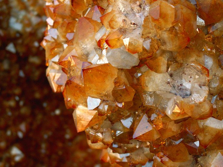 Heat-treated Amethyst (Citrine) Color is typically more concentrated in the points and orange color is often mixed with clear and white bases.
