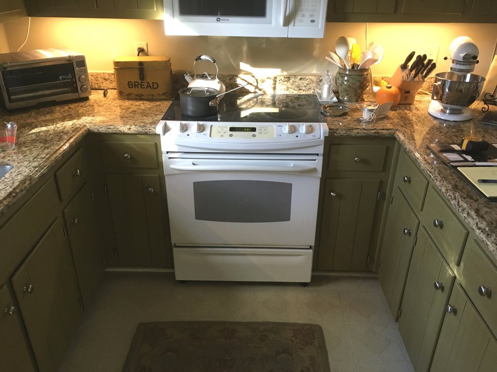 Before: original cabinets, vinyl flooring, white appliances