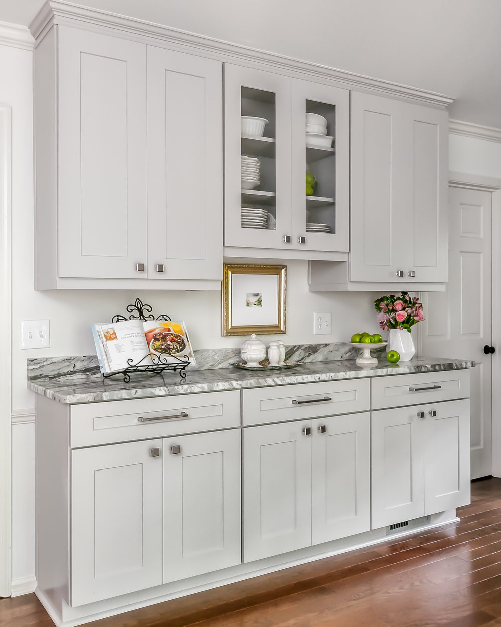 This beautiful butler pantry replaced the desk and pantry closets, and is perfect for storage, display, and for serving guests when entertaining.