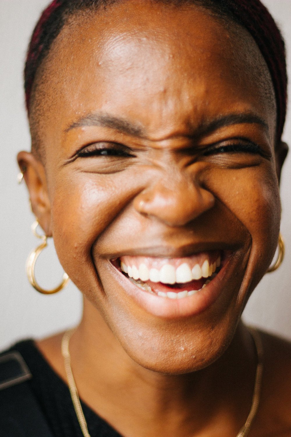 A black woman laughing.