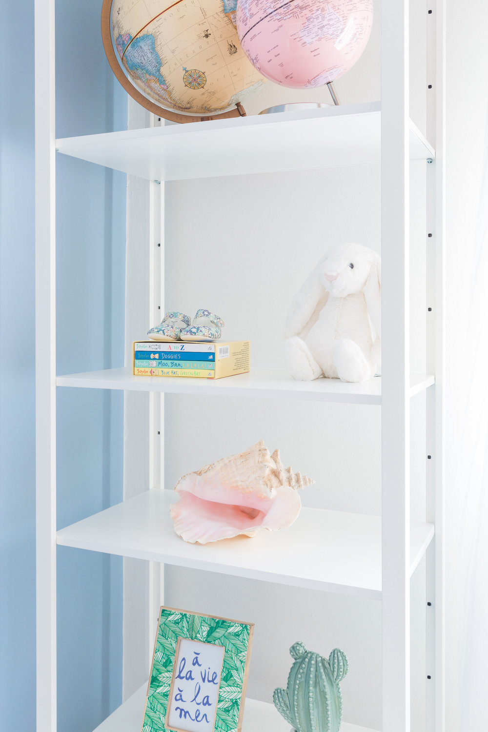baby seale nursery - styled shelves