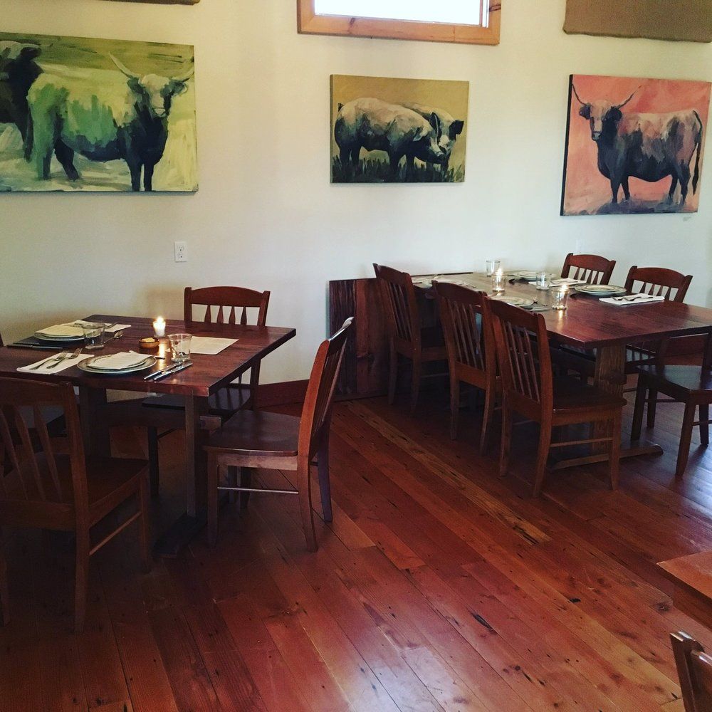 Farmhouse Dining Room with Laura Hudson's Paintings